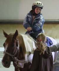 Kayla riding a horse